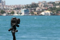 A camera on tripod for time lapse shooting