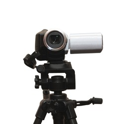 a camera on tripod isolated on white
