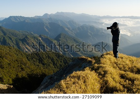 A cameraman standed and shot in the peak.