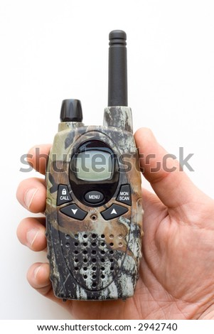 A camouflage two-way radio held in hand