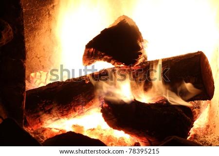 a campfire burning logs