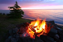 A campfire on the beach is a wonderful way to relax on a beautiful summer day