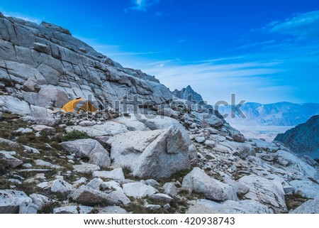 A camping tent in the mountains #420938743