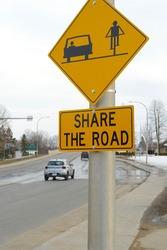 A Canadian roadsign informing traffic to share the lanes with cyclists as well as motor vehicles.