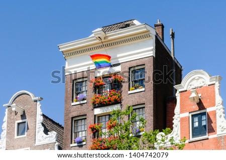A canal house flies a rainbow flag for Gay Pride #1404742079