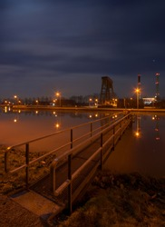 A canal lock of the Wesel-Datteln-Canal in Germany, the towers in the background belong to an aluminium plant.