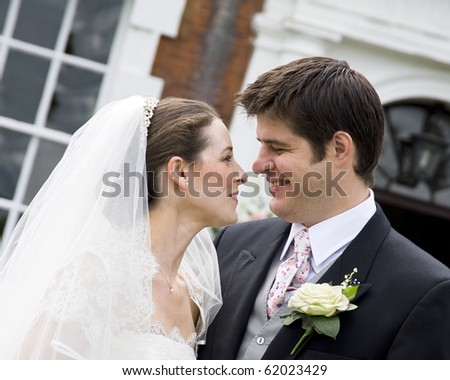 A candid shot of an intimate moment between bride and groom