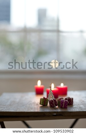 A candle and Christmas tree - stock photo