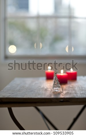 A candle and Christmas tree