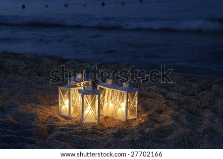 a candle lights by the sea in a tourist resort place