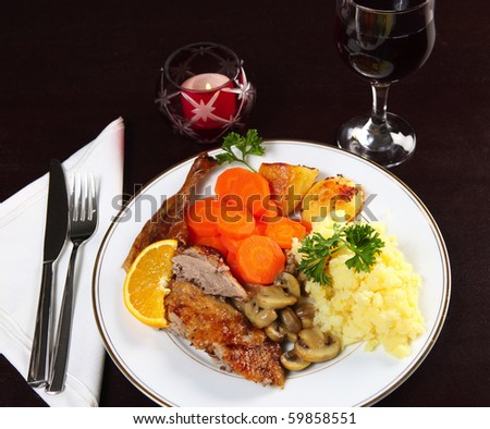 A Candle-Lit Dinner Of Roast Duck, Potatoes, Carrots And ...
