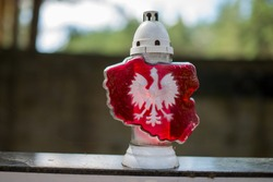 A candle snitch with the Polish emblem. National mourning. Red candle in the shape of a map of Poland with a white eagle. Mourning. Funeral. Patriotism. Poland. All the saints day. 11 Novembre