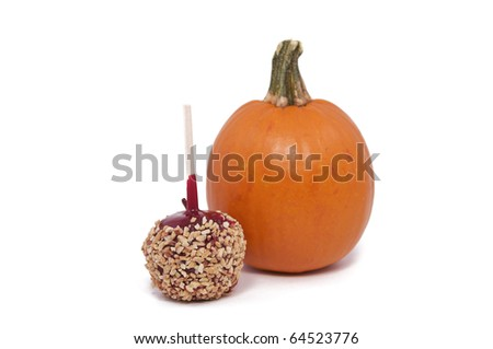 A Candy Apple and Small Pumpkin Isolated against a White Background - stock photo