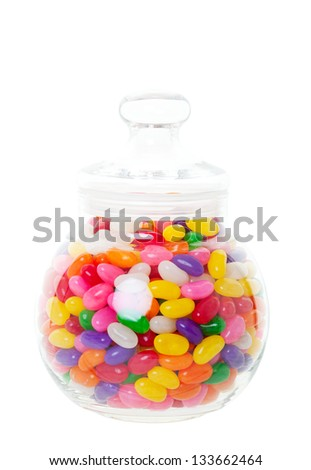 A candy jar full of jelly beans.  Shot on white background.