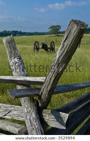 A cannon framed by rail fence posts at Antietam Civil War Battlefield in Sharpsburg, Maryland, USA