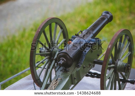 A cannon that shoots cores. Burning wick. The current model of an old artillery gun. #1438624688