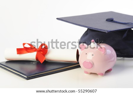 A cap, diploma and piggy bank isolated on white