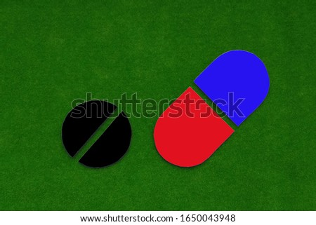 A capsule, a tablet against a green background. Medicines, medicines. the medicine.