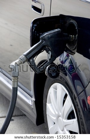 A car being filled up with gas.