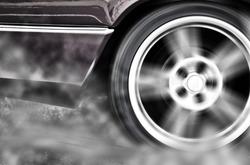 A car burnout at a drag racing track