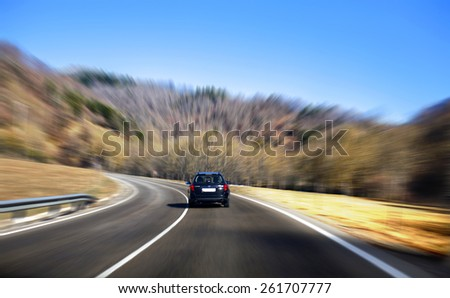 A car driving with high speed with blur background