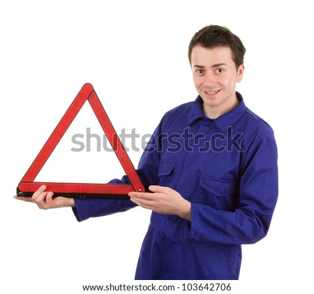 A car mechanic with a hazard warning triangle, isolated on white