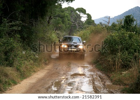 A car sprays mud. Surmounting the wild area. Ride on the of-road car. 4x4 off-roading in Croatia.