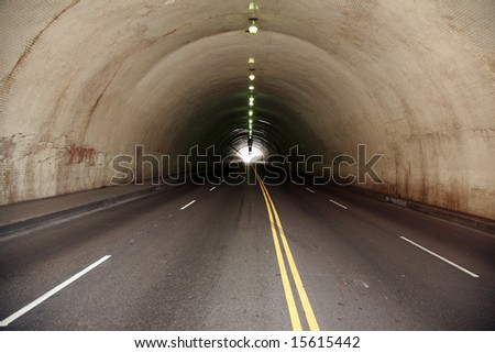 a car tunnel in a urban city