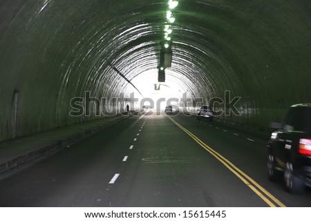 a car tunnel in a urban city