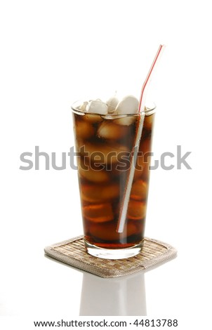 A carbonated soft drink against a white background