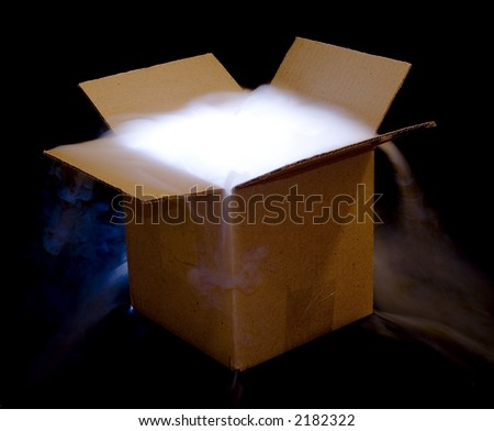 A cardboard box illuminated from within, with smoke spilling over the top.