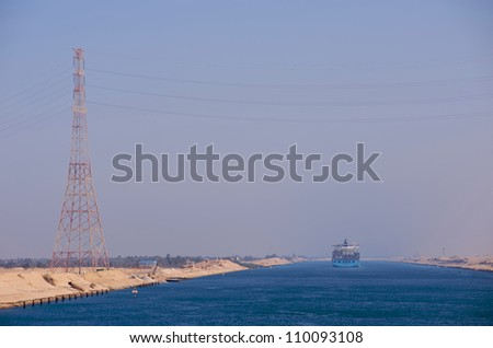 A cargo ship transits northbound through the Suez Canal.