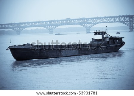 a cargo vessel sailing on the chinese yangtze river