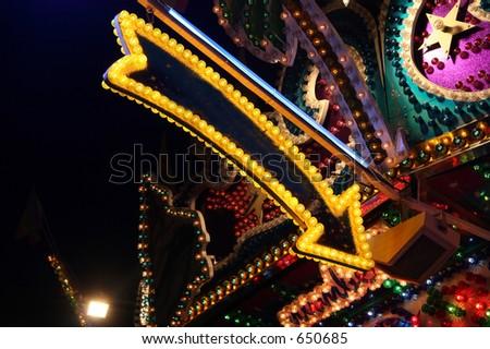 A carnival arrow in yellow