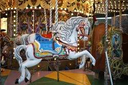 A carousel horse merry go round with galloping horses