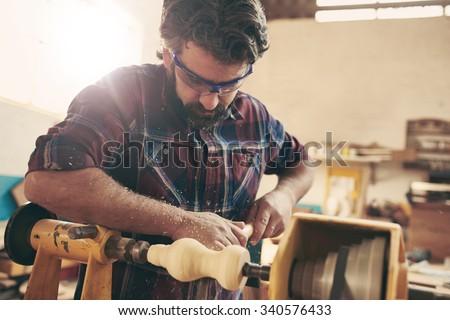 A carpenter doing wood turning