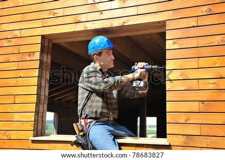 a carpenter working in his house