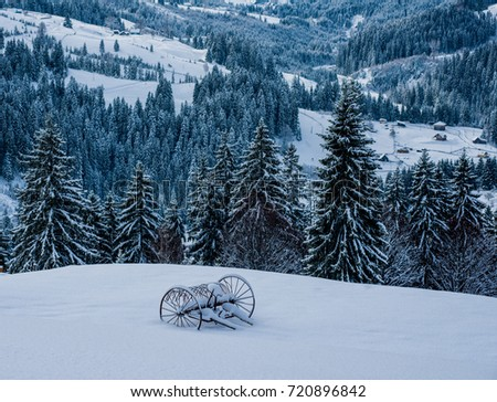 a cart in the snow in the mountains #720896842