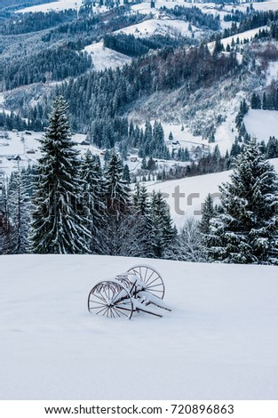 a cart in the snow in the mountains #720896863