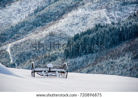 a cart in the snow in the mountains #720896875