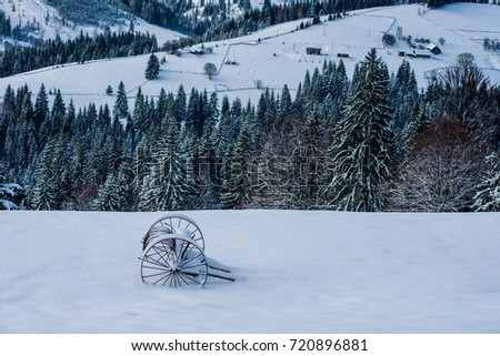 a cart in the snow in the mountains #720896881