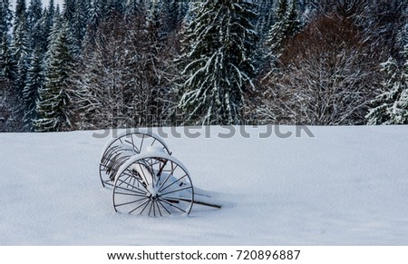 a cart in the snow in the mountains #720896887