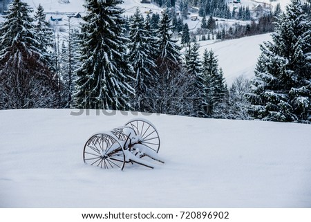 a cart in the snow in the mountains #720896902