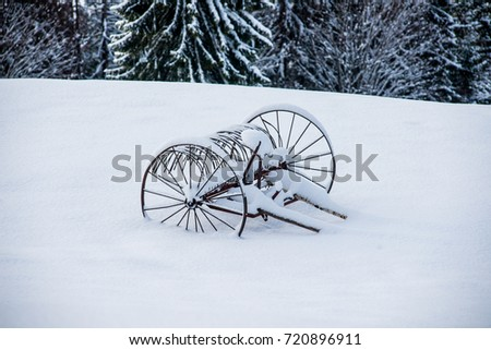 a cart in the snow in the mountains #720896911