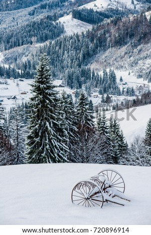 a cart in the snow in the mountains #720896914