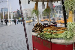 A cart selling roasted corn and chestnuts in Istanbul  , letters With  KESTSNE Means chestnuts and letters With MISIR Means corn