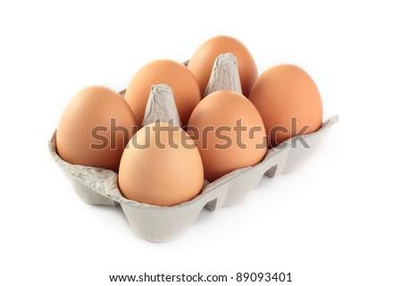 A carton of fresh free range eggs on a white background.
