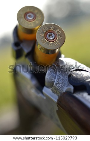 A cartridge loaded and ready in an under and over 12 bore shotgun