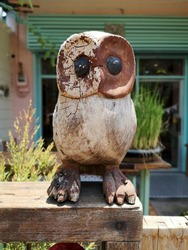 A carved wooden Owl laying on the wall with a blurred background and clipping path.