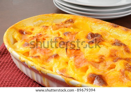 A casserole dish of au gratin potatoes with ham